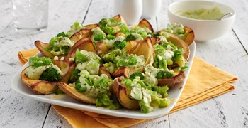 Quarter potato skins with avocado filling