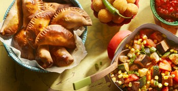 Argentinian Empanadas Filled With Meat And Olives Served With Hot Jalapeno Balls
