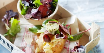 Jacket Potato With Salad Mix Beefsteak And Herb Butter